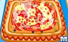Cocina en el juego una pizza de masa cuadrada